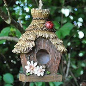 """Décoration maison d'oiseau de jardin en résine avec """"Toit de chaume"""" et de détails Coccinelle–17cm de la marque Fiesta image 0 produit"""